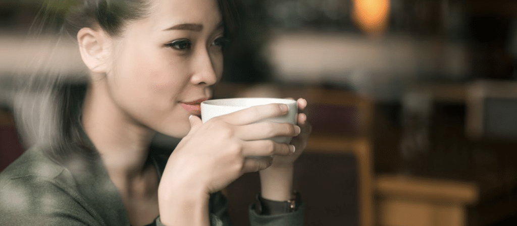 Young Woman Drinking Broth